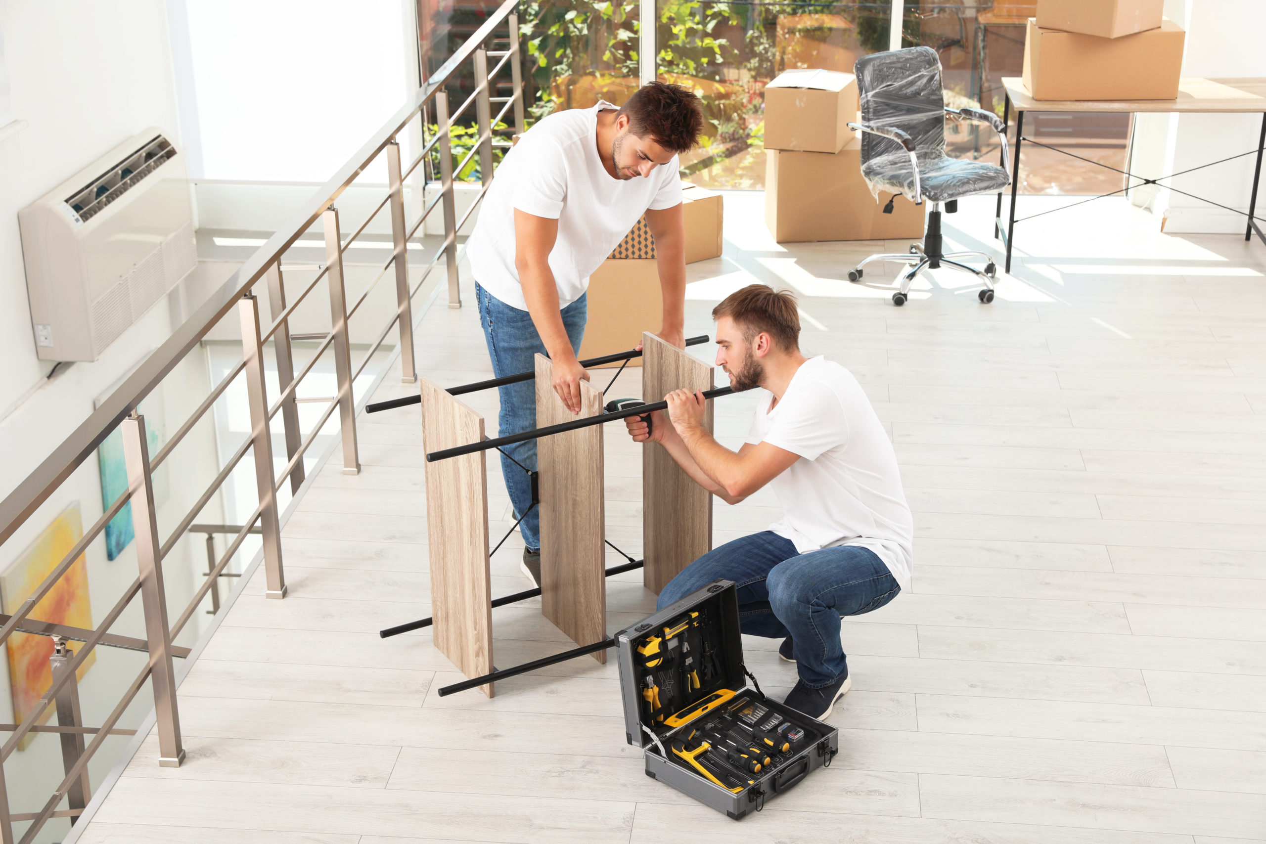 Professional workers disassembling rack in office. Moving service